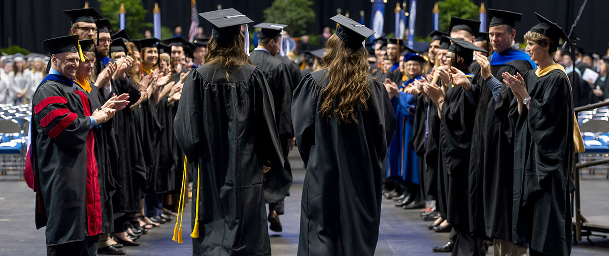 faculty clapping during the student processional